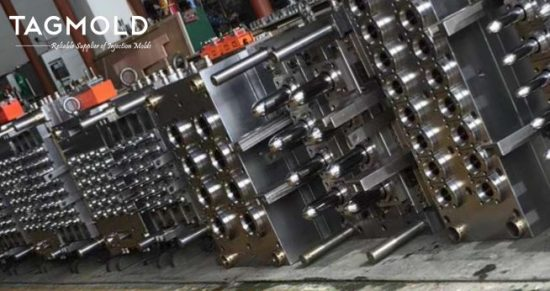 Several pairs of preform molds stand display